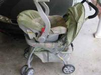 Boys car seat with stroller and the base for the car.