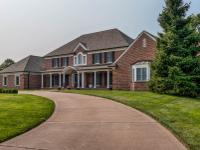 This stately 16-year old custom home offers superior