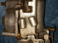 S&S Carburetor. Missing three screws and one nut. See