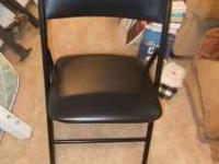 Black card table with four chairs. Good condition, some