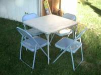 folding card table n 4 mteal chairs nice shape 20$ call