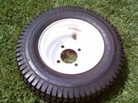 16x6.50-8 Carlisle turf saver brand new tires and rims.