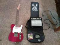 electric carlson guitar with amp, tuner, strings, and