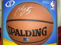 spalding basketball, signed by carmelo anthony himself.