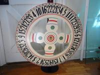 This vintage colorfully hand-painted wheel (red, blue,