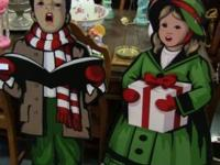 Carolers. Set of 2, boy and girl. Each measures 48""
