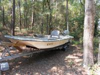 16 foot Carolina Skiff with a 4 stroke 15hp Suzuki.