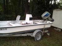 For sale is a center console J16 carolina skiff with a
