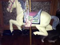 Adorable carousel horse made from a child size hobby