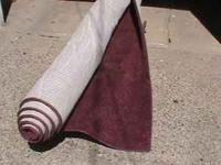 This is a solid red/burgundy carpet (area rug) with