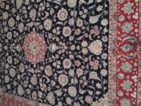 1. (Black Persian Kirman Carpet 8 x 11 $1,500) This