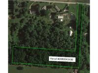 Hard to find wooded 5+ acre lot in Bloom Carroll School