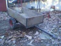 Homemade heavy duty two wheeled cart. 48 inches long by