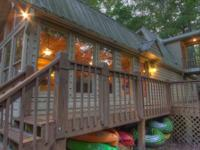 This riverfront 2 bedroom/ 2 bath cabin has everything