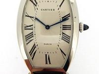 Cartier platinum Tonneau, manual, size 39mm x 26mm.