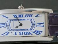 Fancy platinum Cartier Tank Cintre , limited edition of