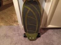 This is a barely used green carve board/long board. In