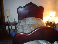 this is a three piece bedroom suite: bed bureau and