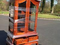 This is an antique Footed Mahagony China cabinet with