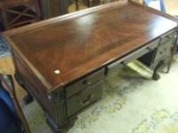 For sale we have a mahogany paw foot executive desk
