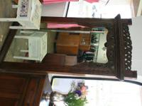 I am selling this awesome large wood carved mirror that
