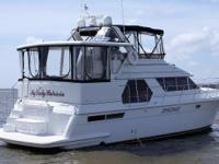 This 1998 Carver 445 Aft Cabin Motor Yacht is powered