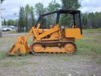 450 Case loader with 4-way bucket, new tracks and