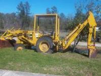 1967 Case Backhoe Loader with a 4 cylinder gas engine.