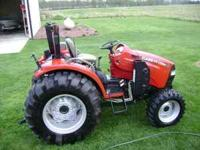 2008 CaseIH D40 with CaseIH L350 loader. 235 hours.