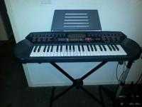 Instructional keyboard with 100 songs built in. With