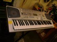 Casio keyboard with stand. Works good. Bulk deals &