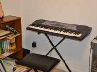 Casio Keyboard (excellent condition) with the rack. $20