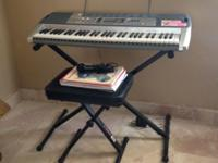 LIKE NEW Casio Keyboard with stand and bench. Original