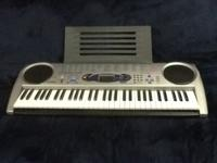 Like new lighted keys learning piano, 100 song bank,