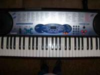 Casio Deluxe Keyboard with stand and headphones 100