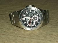 Nice pre-owned watch. I bought it on 8/6/13. 100m water