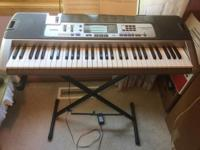 New, unused keyboard piano with stand. Cosmetically
