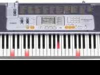 Lightly used Casio LK 100 portable keyboard for sale.