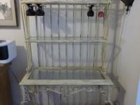 Beautiful cast iron baker's rack with wine glass rack.