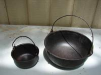 I HAVE 2 BOWLS, CAST IRON, THAT WERE USED FOR HANGING
