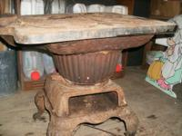 antique cast iron cook stove. rusty, needs