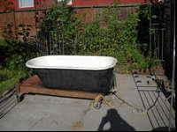 Cast iron porcelain tub has a couple of chips, use as