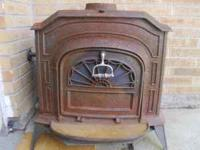 For sale is this Resolute brand cast iron fireplace.