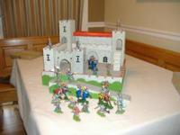 Hand built wooden castle and posable plastic toy