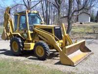 Very nice backhoe, runs great, ext hoe, cab, all glass