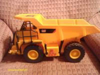 This is a CAT motorized dump truck. It is like new