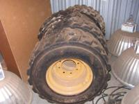 4 CAT.New Tires and Rims 12x16.5NHS 10 ply--- Also have