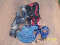 Catchers gear made by Rawlings and a mitt by Wilson and
