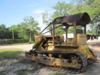 Here is a Cat D-7 Dozer with 12 foot blade. Machine