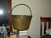 This is an antique cast iron rendering pot or syrup